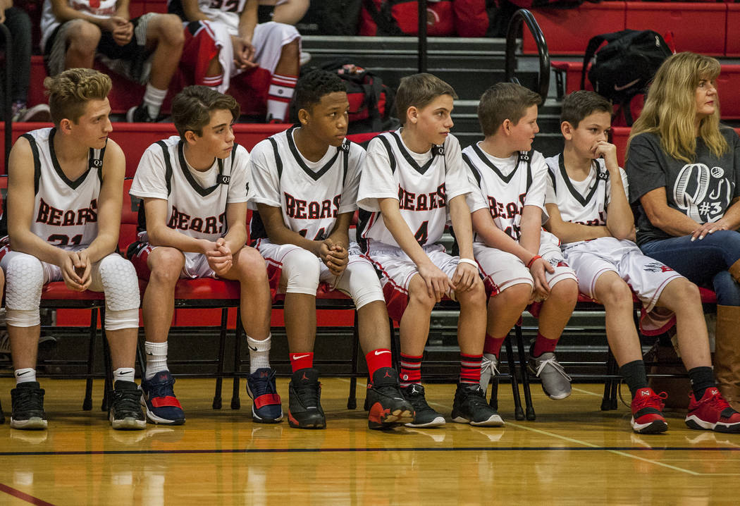 The boys' basketball team, including Quade Robbins, second from right, listens to speeches during a ceremony to remember Quinton Robbins, a victim of the Oct. 1 shooting, at the B. Mahlon Brown Ac ...