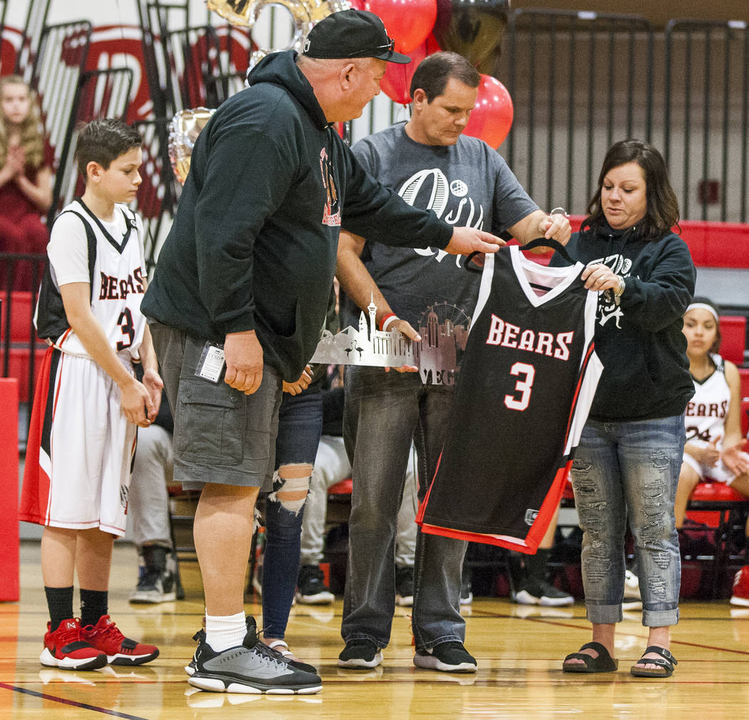 The family of Quinton Robbins, a victim of the Oct. 1 shooting, receives his retired #3 jersey at the B. Mahlon Brown Academy of International Studies on Wednesday, Jan. 17, 2018.  Patrick Connoll ...