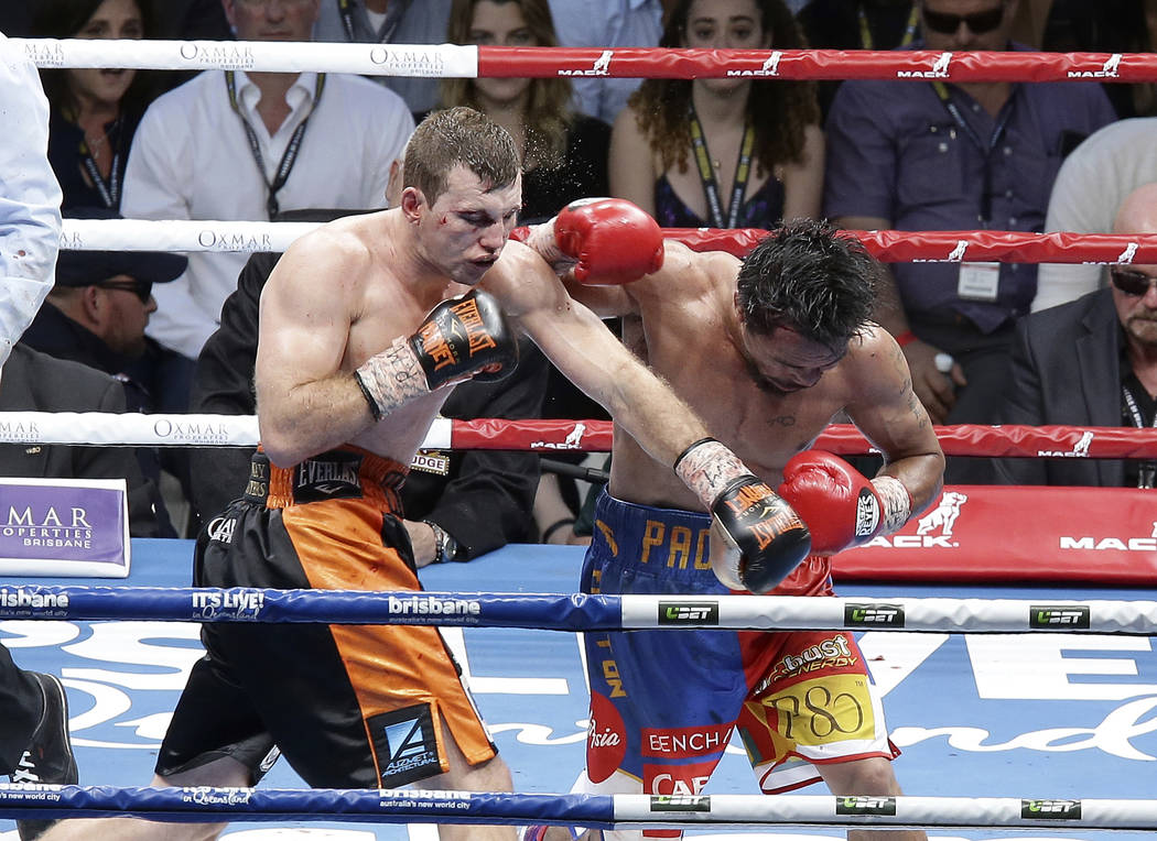 Jeff Horn of Australia, left, lands a left to  Manny Pacquiao of the Philippines, right, during their WBO World Welterweight title fight in Brisbane, Australia, Sunday, July 2, 2017.  Pacquiao los ...