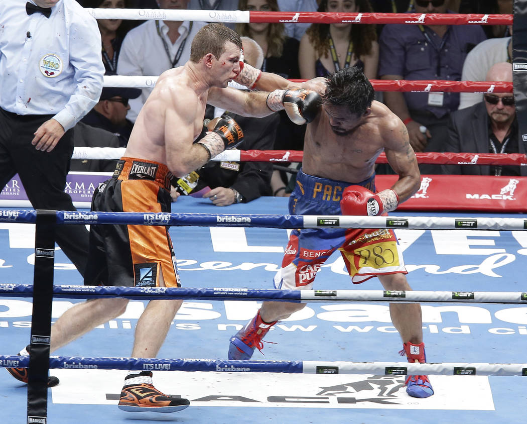 Jeff Horn of Australia, left, and Manny Pacquiao of the Philippines, right, lands a left to during their WBO World Welterweight title fight in Brisbane, Australia, Sunday, July 2, 2017.  Pacquiao  ...