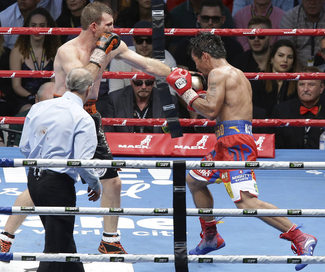 Jeff Horn of Australia, left, lands a left to Manny Pacquiao of the Philippines, right, during their WBO World Welterweight title fight in Brisbane, Australia, Sunday, July 2, 2017.  Pacquiao lost ...