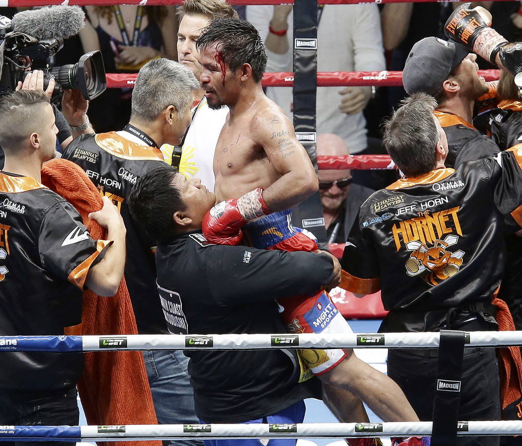 Manny Pacquiao of the Philippines reacts after his loss to Jeff Horn of Australia, during their WBO World Welterweight title fight in Brisbane, Australia, Sunday, July 2, 2017. (AP Photo/Tertius P ...