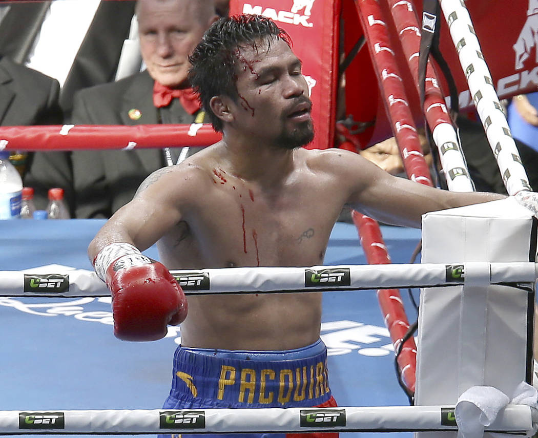 In this Sunday, July 2, 2017, file photo, Manny Pacquiao of the Philippines reacts after his loss to Jeff Horn of Australia, during their WBO World Welterweight title fight in Brisbane, Australia. ...