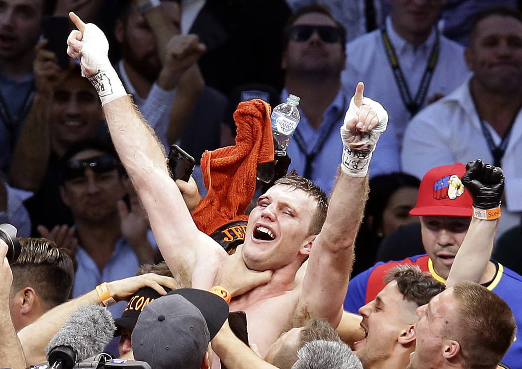 FILE - In this July 2, 2017, file photo, Jeff Horn, of Australia, celebrates after beating Manny Pacquiao, of the Philippines, during their WBO World Welterweight title fight in Brisbane, Australi ...