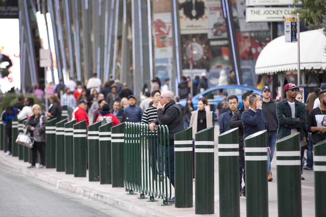 People walk past recently installed safety bollard on the Vegas Strip on Tuesday, Jan. 2, 2018. Richard Brian Las Vegas Review-Journal @vegasphotograph