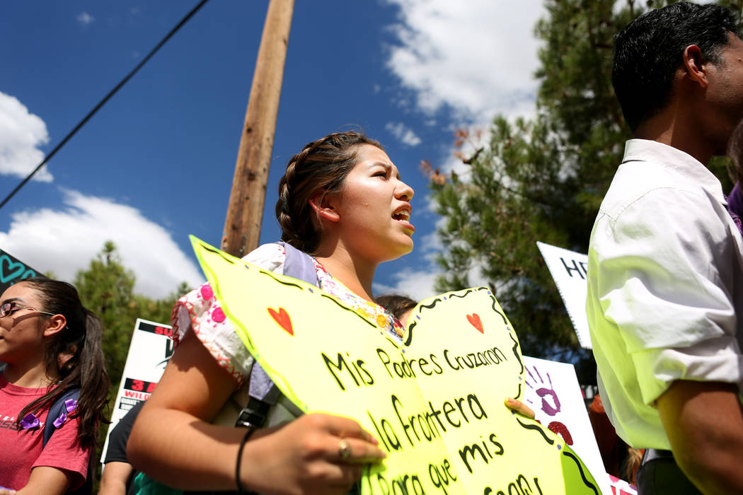 High school student Jennifer Avalos, 17, supports her family and friends affected by DACA during a rally in support of the DREAM Act, at Rancho high school in Las Vegas, Wednesday, Sept. 13, 207.  ...
