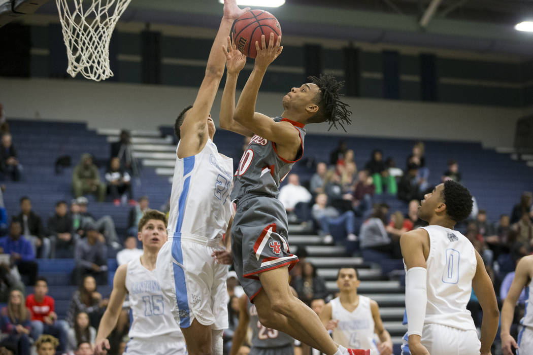Arbor View's Comillion Smith (20) goes up for a shot against Centennial in the basketball game at Centennial High School in Las Vegas, Wednesday, Jan. 17, 2018. Erik Verduzco Las Vegas Review-Jour ...