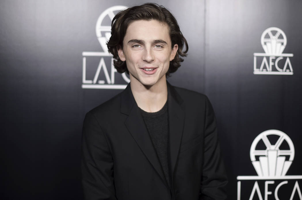 FILE - In this Jan. 13, 2018, file photo, Timothee Chalamet attends the 43rd Annual Los Angeles Film Critics Association Awards in Los Angeles. Chalamet said he will donate his salary for an upcom ...