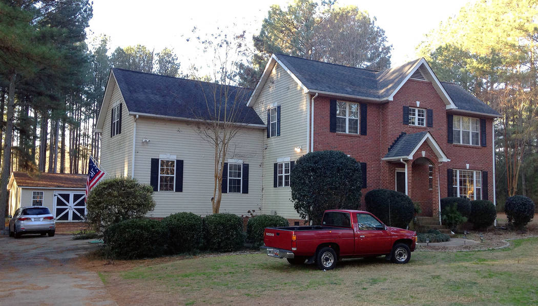 Cars are parked at a home in York, S.C. on Tuesday, Jan. 16, 2018, where multiple deputies responding to a domestic violence call were shot and wounded. State Law Enforcement Division spokesman Th ...