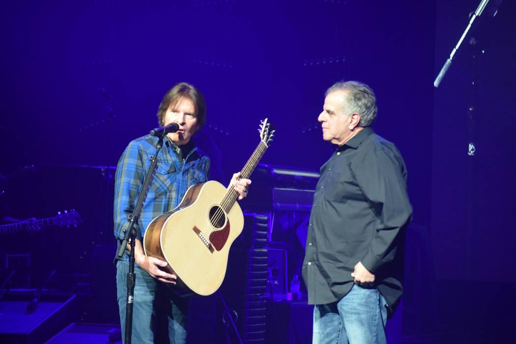 Rock great John Fogerty presents a new Gibson guitar to Las Vegas Veterans Crisis Intervention Center founder Arnold Stalk at Encore Theater at Wynn Las Vegas. (John Fogerty)