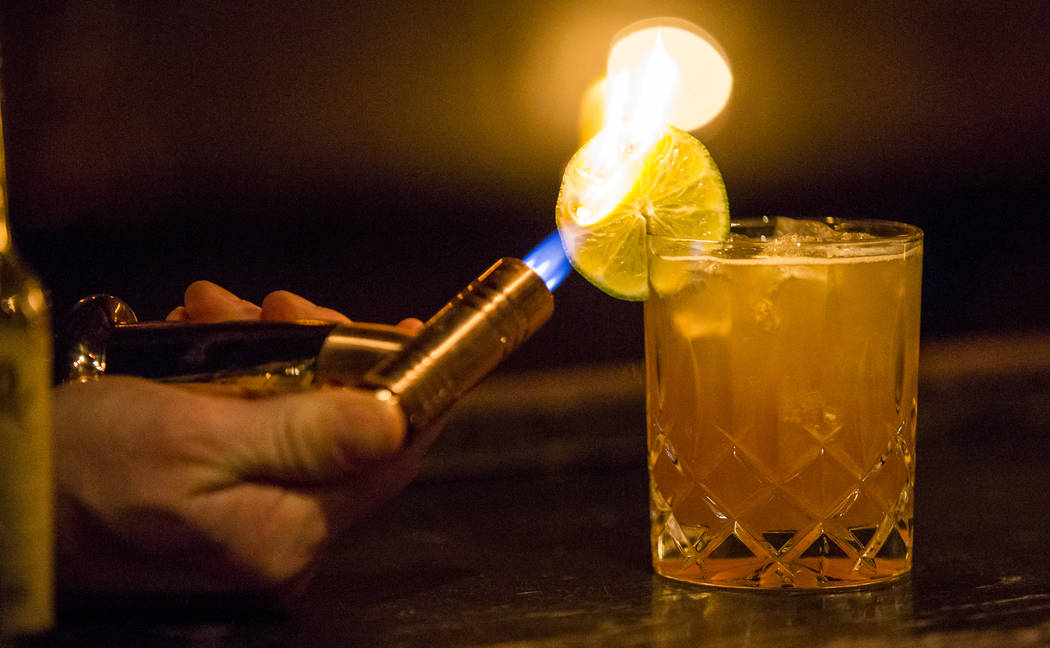 Bartender Anthony Partridge lights the cloves on a Tam Tam cocktail on fire at the Laundry Room in Las Vegas on Tuesday, Jan. 16, 2018.  Patrick Connolly Las Vegas Review-Journal @PConnPie