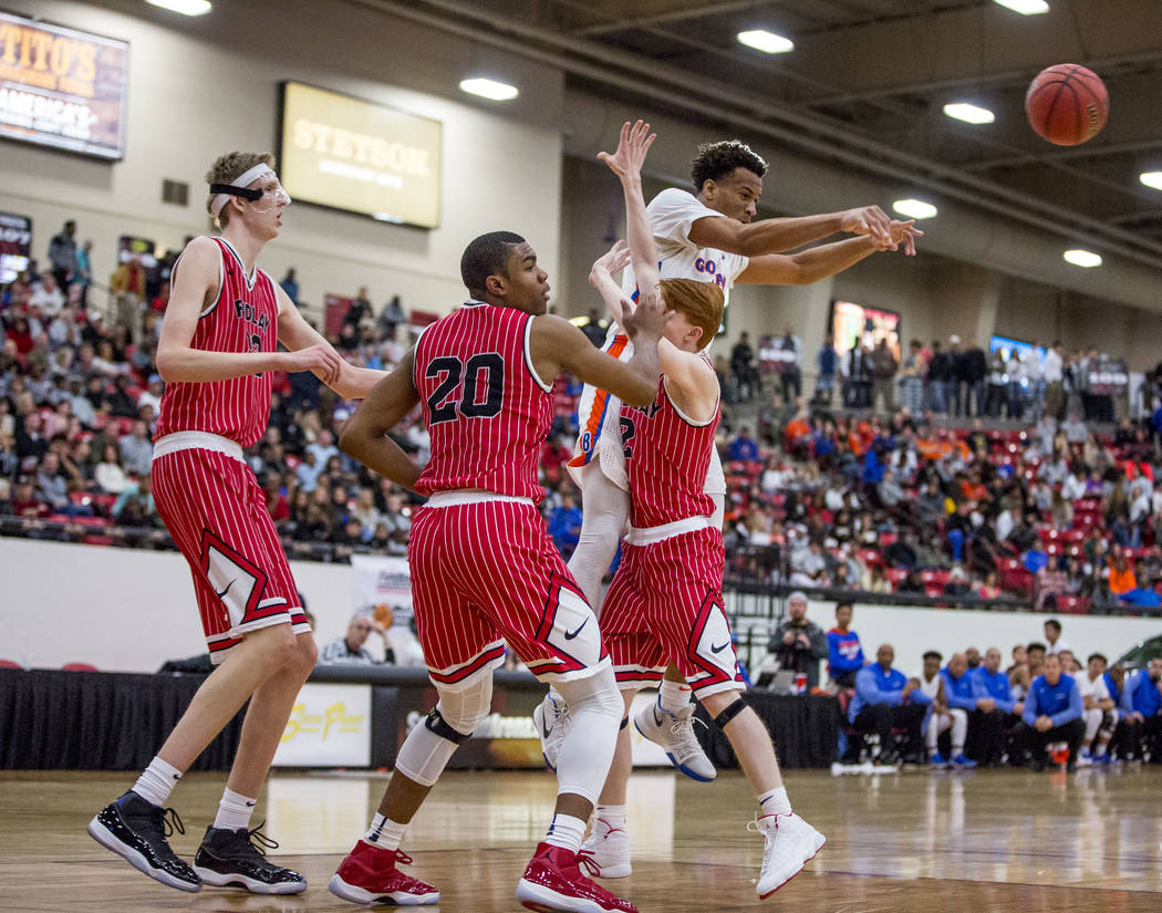 Bishop Gorman forward Zim Agu (13) looks for a pass while Findlay Prep defenders Connor Vanover (23), Reggie Chaney (20) and Dillon Glendenning (2) try to block him during the Big City Showdown at ...