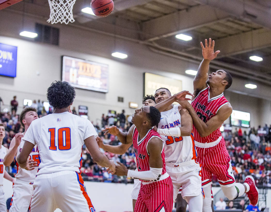 Findlay Prep's Reggie Chaney (20), right, loses control of the ball as Bishop Gorman's Zaon Collins (10) and Jamal Bey (35) look  to get to the rebound while Findlay Prep's TJ Moss (1) watches the ...