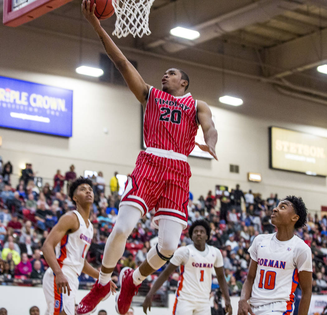 Findlay Prep's Reggie Chaney (20) looks to make a layup while Bishop Gorman's Isaiah Cottrell (0), Will McClendon (1) and Zaon Collins (10) watch during the Big City Showdown at South Point in Las ...