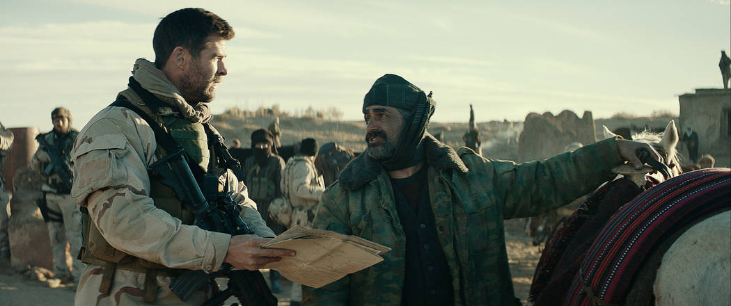 "CHRIS HEMSWORTH, left, as Captain Mitch Nelson and NAVID NEGAHBAN as General Dostum in ""12 STRONG,"" (Warner Bros. Pictures)"