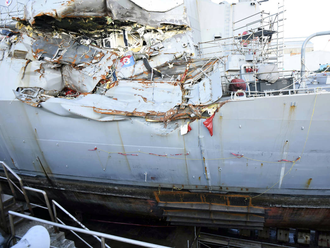 In this July 11, 2017 file photo, provided by the U.S. Navy, the USS Fitzgerald sits in dry dock in Yokosuka, Japan, to continue repairs and assess damage sustained from a June 17 collision with a ...