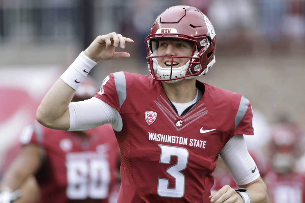 In this Sept. 17, 2016 file photo, Washington State quarterback Tyler Hilinski (3) runs onto the field with his teammates before an NCAA college football game against Idaho in Pullman, Wash. Hilin ...