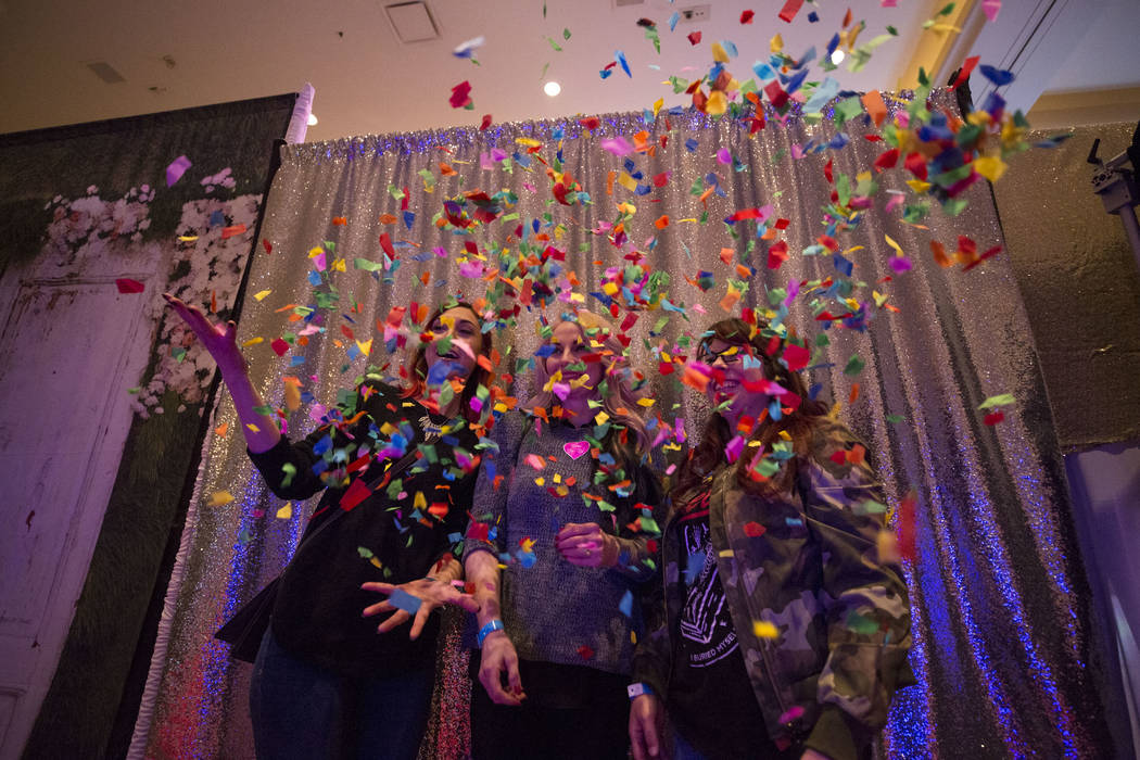 Guests take a photo in Shutter Booth's animated GIF photo booth during the Bridal Spectacular wedding expo at the Rio Convention Center in Las Vegas on Sunday, Jan. 21, 2018. Richard Brian Las Veg ...