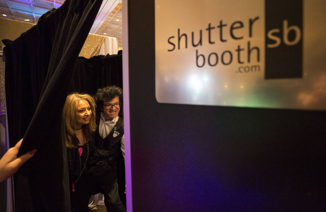 Engaged couple Denise Ippolito and Patrick Harris pose in a Shutter Booth photo booth during the Bridal Spectacular wedding expo at the Rio Convention Center in Las Vegas on Sunday, Jan. 21, 2018. ...