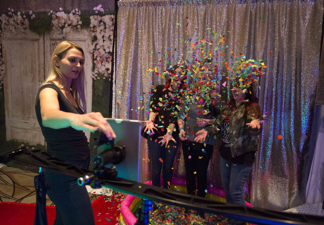 Shutter Booth host Rachel Amerine, left, demos the animated GIF photo booth during the Bridal Spectacular wedding expo at the Rio Convention Center in Las Vegas on Sunday, Jan. 21, 2018. Richard B ...