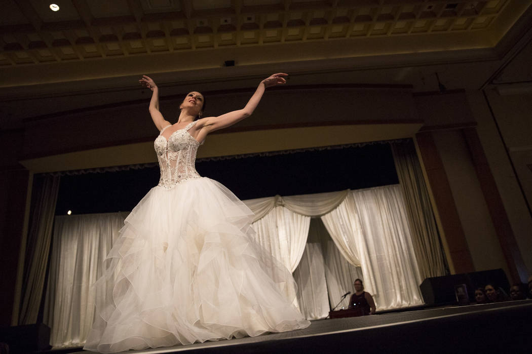 A model demos a wedding dress on the catwalk during the Bridal Spectacular wedding expo at the Rio Convention Center in Las Vegas on Sunday, Jan. 21, 2018. Richard Brian Las Vegas Review-Journal @ ...