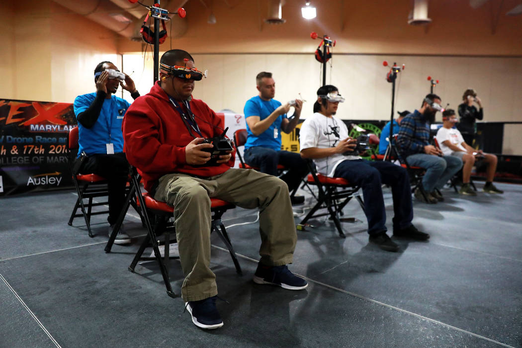 Eddel Veloso, 42, left, competes in the 2017 Challengers Cup Finals, hosted by the International Drone Racing Association and the South Point in Las Vegas, Jan. 18, 2018. After 12 races around the ...