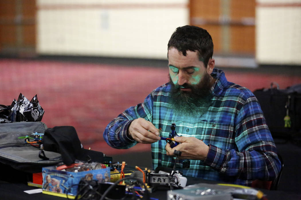 Jesse Swinson, a 39-year-old participant from Ohio, adjusts his drone after competing in the 2017 Challengers Cup Finals, hosted by the International Drone Racing Association and the South Point i ...