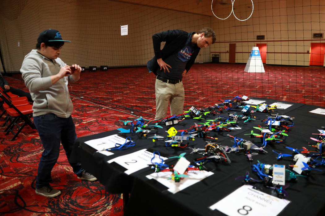 Garrett Bentley, 27, and Noah Schnapp, 29, check out the competing drones during the 2017 Challengers Cup Finals, hosted by the International Drone Racing Association and the South Point in Las Ve ...