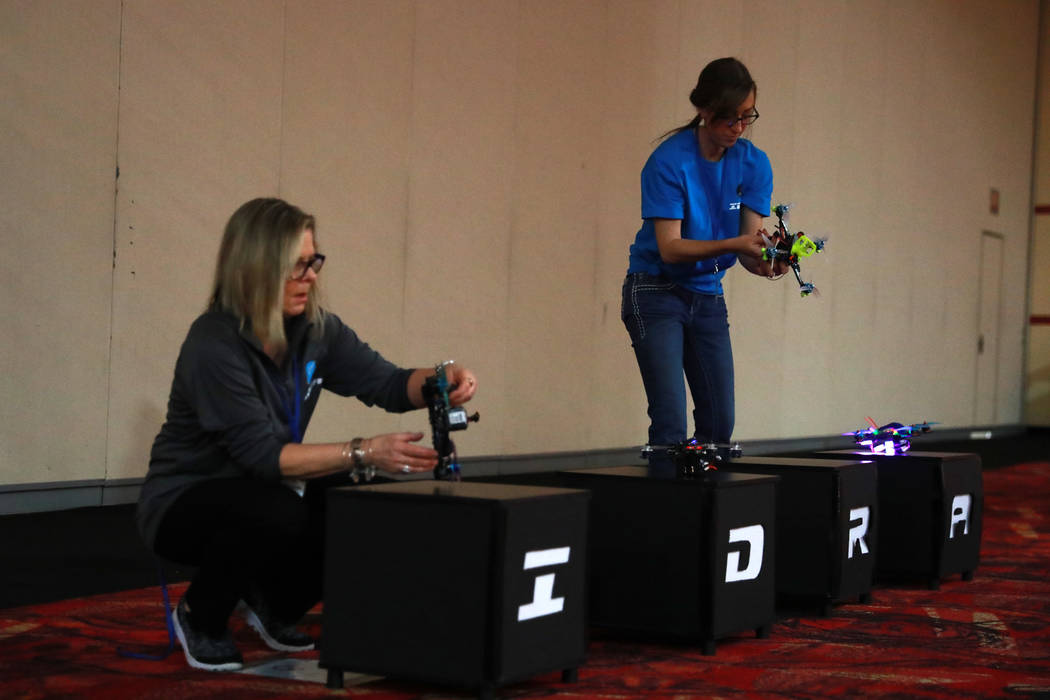 Bonnie Haggerty and Sam Fletcher set up the competing drones for the 2017 Challengers Cup Finals, hosted by the International Drone Racing Association and the South Point in Las Vegas, Jan. 18, 20 ...