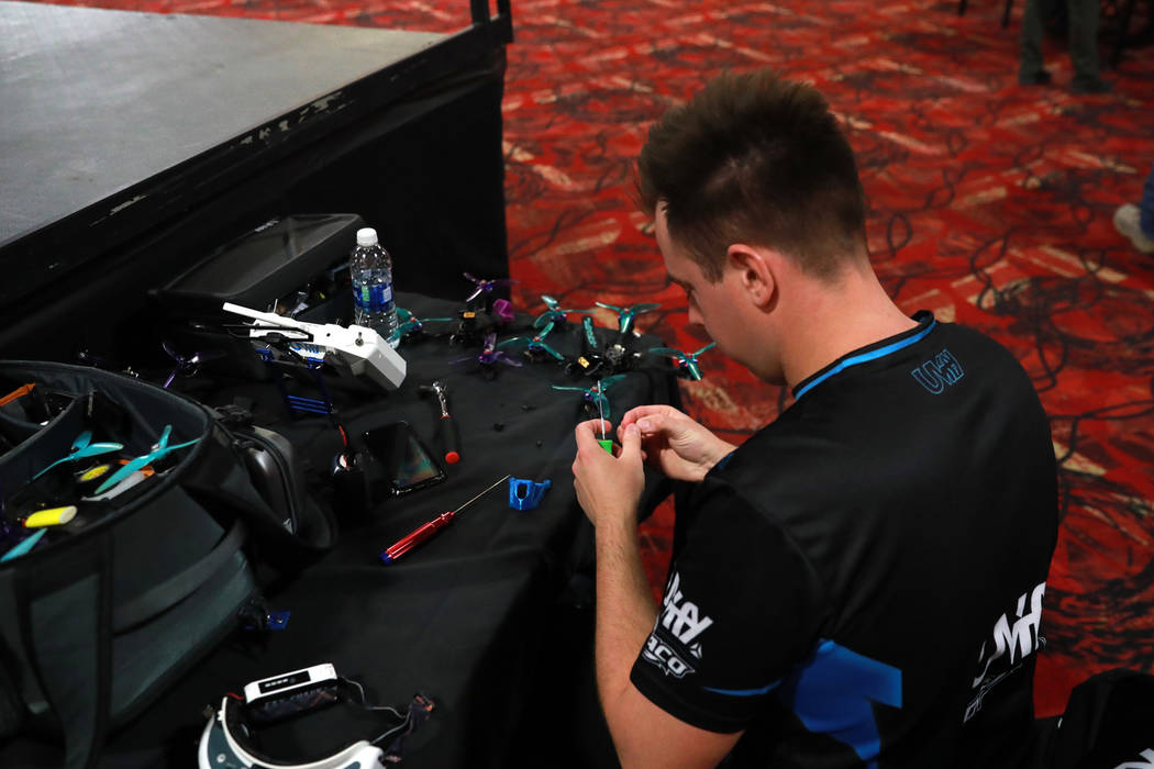 Corey Csaba, a 28-year-old participant from Canada, adjusts his drone during the 2017 Challengers Cup Finals, hosted by the International Drone Racing Association and the South Point Hotel in Las  ...