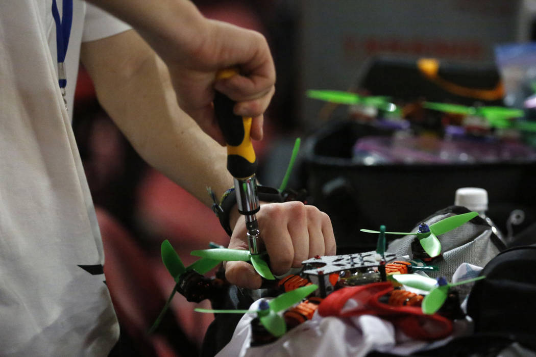 Doga Canturk, an 18-year-old participant from Canada, tightens the props on his drone during the 2017 Challengers Cup Finals, hosted by the International Drone Racing Association and the South Poi ...