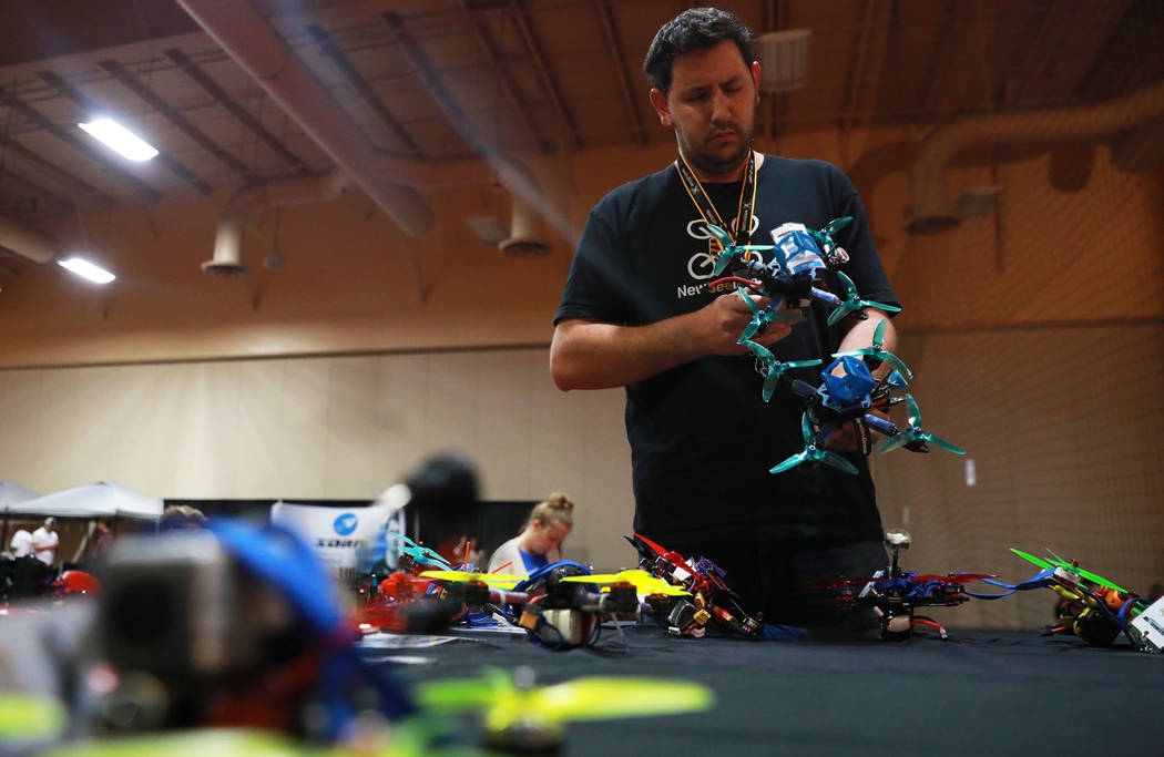 Ori Paamoni, a 30-year-old participant from California, adjusts the camera angles on the drones during the 2017 Challengers Cup Finals, hosted by the International Drone Racing Association and the ...