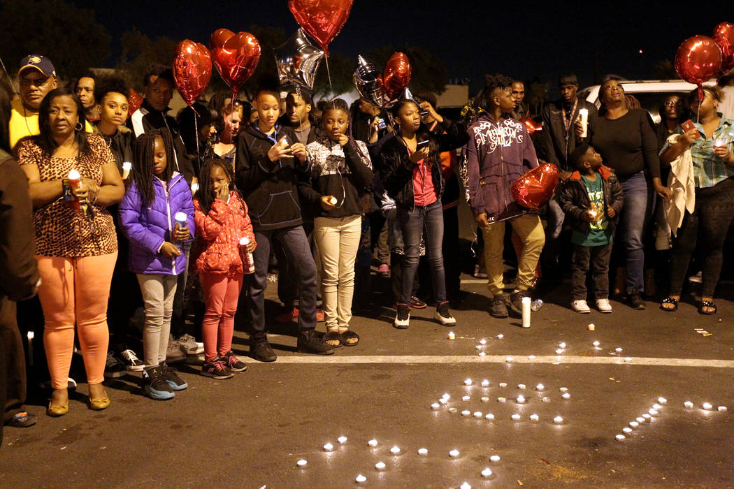 Loved ones gather during a vigil for Jamar Taylor Wednesday, Jan. 17, 2018, at Kensington Suites, 2200 W. Bonanza Road, near Rancho Drive in Las Vegas. Family identified Taylor as the man killed T ...