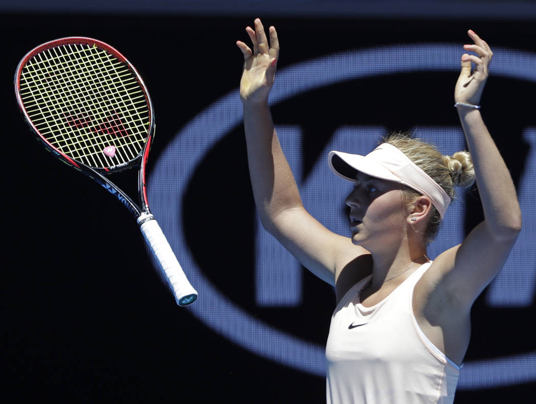 Ukraine's Marta Kostyuk celebrates after defeating Australia's Olivia Rogowska during their second round match at the Australian Open tennis championships in Melbourne, Australia, Wednesday, Jan.  ...