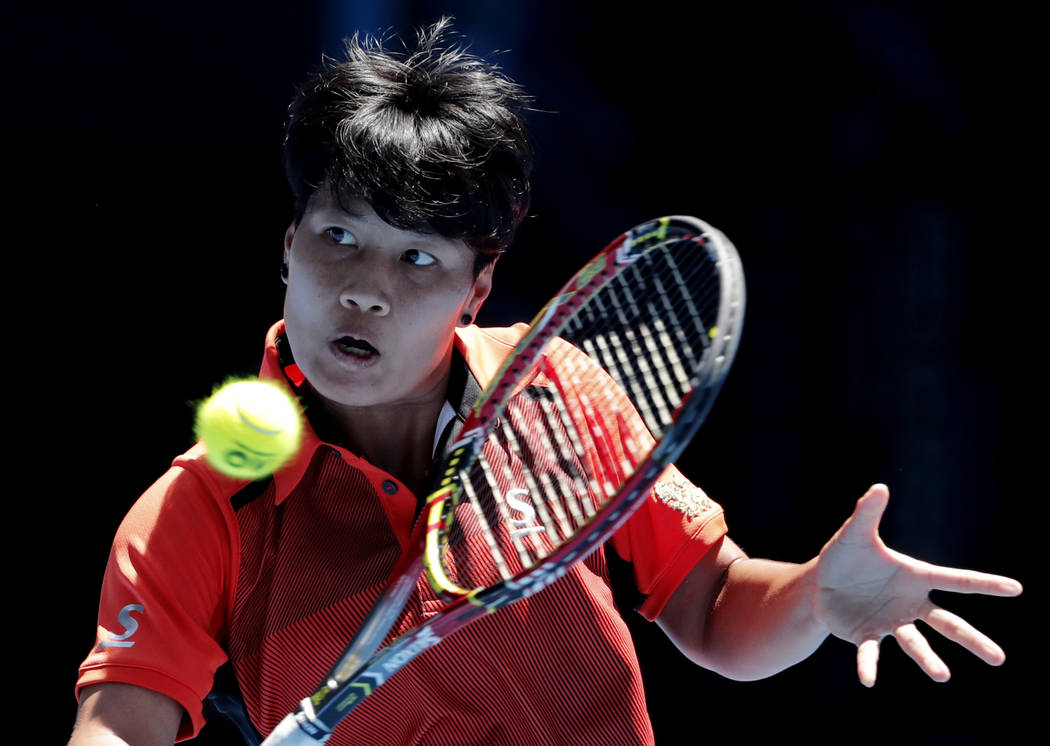 Thailand's Luksika Kumkhum plays a return shot to Switzerland's Belinda Bencic during their second round match at the Australian Open tennis championships in Melbourne, Australia, Wednesday, Jan.  ...