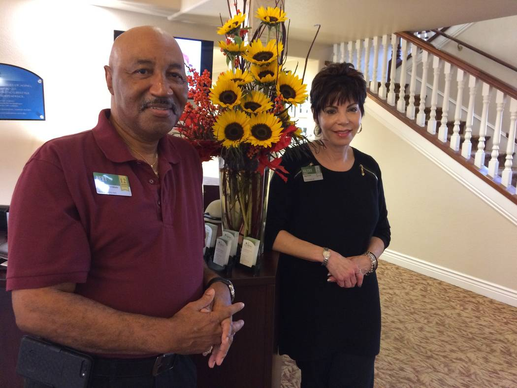 Valerie Howard pauses Nov. 14, 2018, by the front desk of Oakmont of West Las Vegas with one of her staff, Bert Griffin. Howard lists 300 activities a month for the seniors at the facility. Beside ...