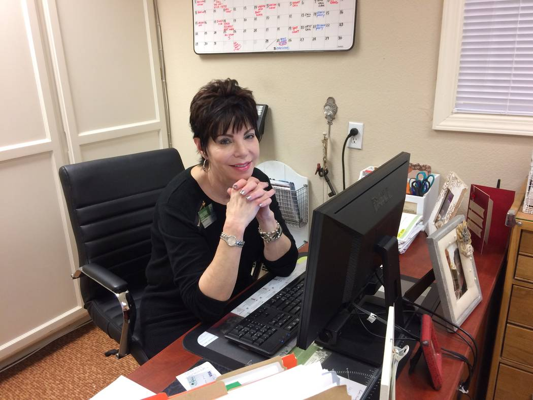 Valerie Howard talks about her job Nov. 14, 2018, as  the activities director for Oakmont of West Las Vegas. She's seldom at her desk as she oversees a variety of things for senior residents to do ...