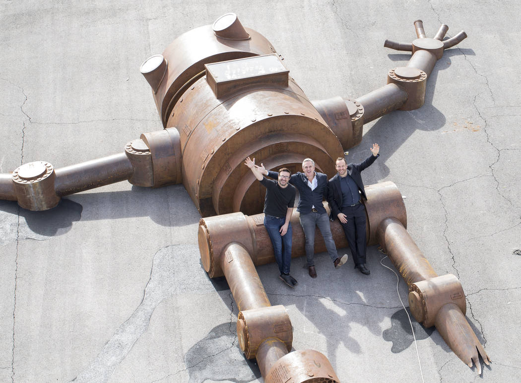 Vince Kadlubek, co-founder and CEO of Meow Wolf, from left, Michael Beneville, founder and CEO of Beneville Studios and developer Winston Fischer, of Fisher Brothers, pose on the Mechan 9 art inst ...