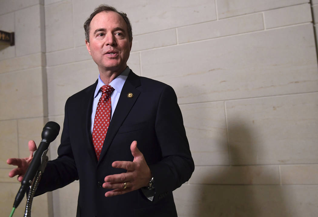 Rep. Adam Schiff, D-Calif., a Democrat on the House Intelligence Committee's Russia investigation, speaks to reporters on Capitol Hill in Washington, Tuesday, Jan. 16, 2018, following the committe ...