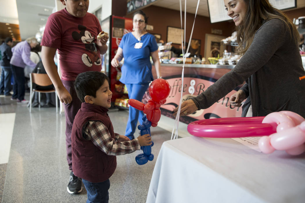 Isaiah Gutierrez, 3, receives a ballon from Corina Smith of Balloons With A Twist during a 10th anniversary celebration at Centennial Hills Hospital in Las Vegas, Saturday, Jan. 20, 2018. Erik Ver ...