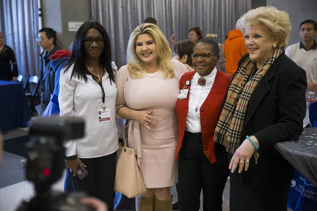 Clinical Staff Pharmacist Chimezie Udom, from left, Councilwoman Michele Fiore, nutrition assistant Edith Williams Pryme, and Mayor Carolyn Goodman, during a 10th anniversary celebration at Centen ...