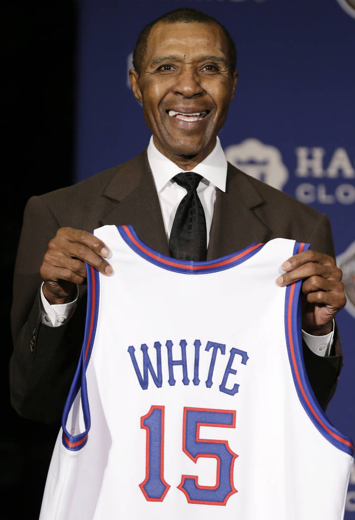 FILE - In this Monday, April 6, 2015 file photo, Former NBA player Jo Jo White stands on stage during the Naismith Memorial Basketball Hall of Fame class of 2015 announcement in Indianapolis. Bask ...