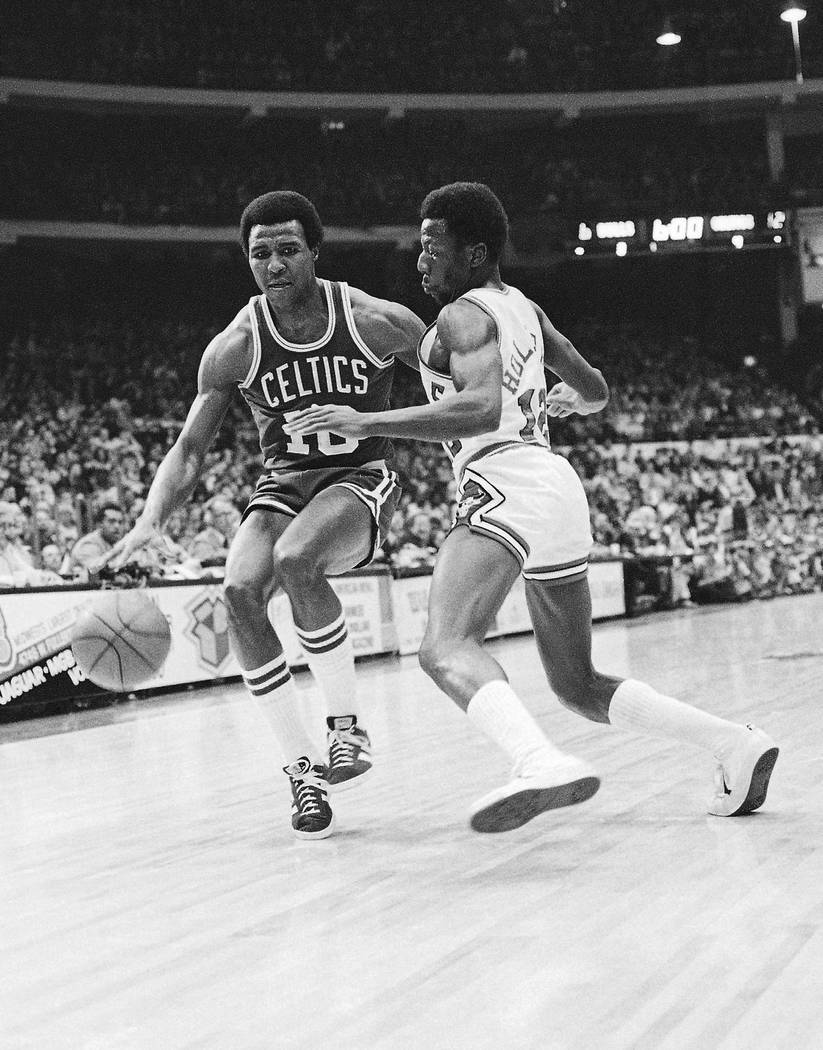 In this Dec. 30, 1977 file photo, Jo Jo White, left, of Boston Celtics, drives past Chicago Bulls' Wilbur Holland (12) during an NBA basketball game in Chicago. Basketball Hall of Famer Jo Jo Whit ...