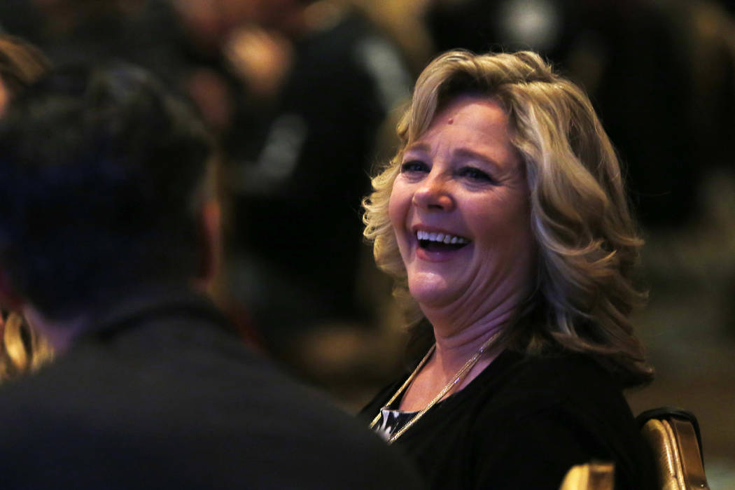 Marilyn Lee reacts after her husband, North Las Vegas Mayor John Lee, thanks her during his State of the City address on Thursday at the Texas Station in Las Vegas, Jan. 18, 2018. Andrea Cornejo L ...
