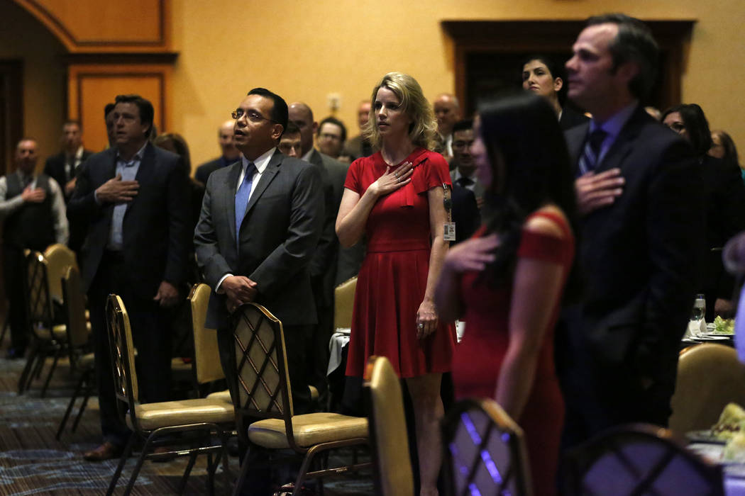 Attendees stand for the pledge of allegiance before North Las Vegas Mayor John Lee's State of the City address on Thursday at the Texas Station in Las Vegas, Jan. 18, 2018. Andrea Cornejo Las Vega ...