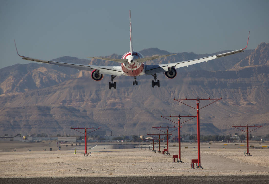 An Air Canada Rouge flight descends as it approaches McCarran International Airport in Las Vegas on Monday, Jan. 22, 2018. Richard Brian Las Vegas Review-Journal @vegasphotograph