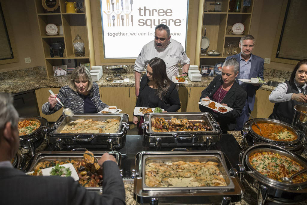 Attendees eat lunch during a media event to announce Three Square food bank's partnership with MGM Resorts International on Wednesday, January 17, 2018, at Three Square, in Las Vegas. The lunch me ...