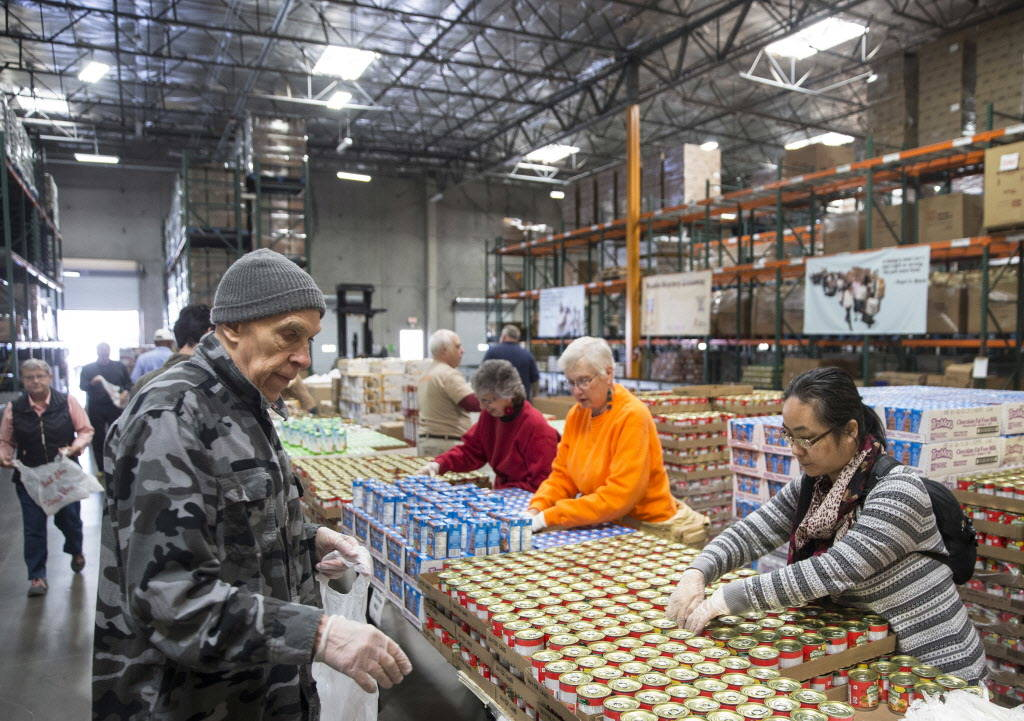 Volunteers unpack donations at Three Square during a media event to announce the food bank's partnership with MGM Resorts International on Wednesday, January 17, 2018, in Las Vegas. Benjamin Hager ...