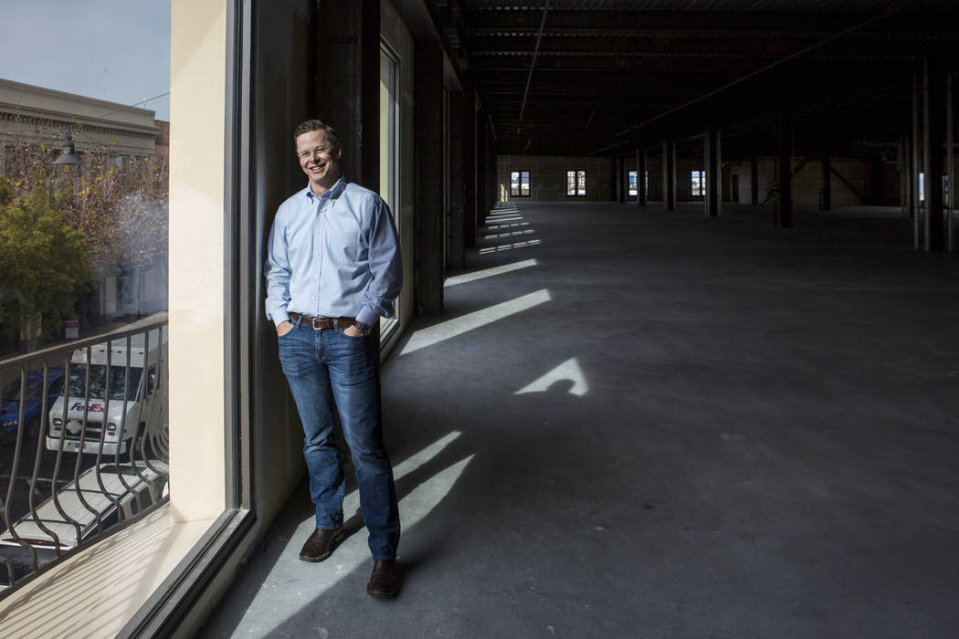 Eric Entringer, vice president of capital markets and investor relations for Dornin Investment Group, DIG, in office space in Town Square recently purchased by DIG for $11.8 million on Thursd ...