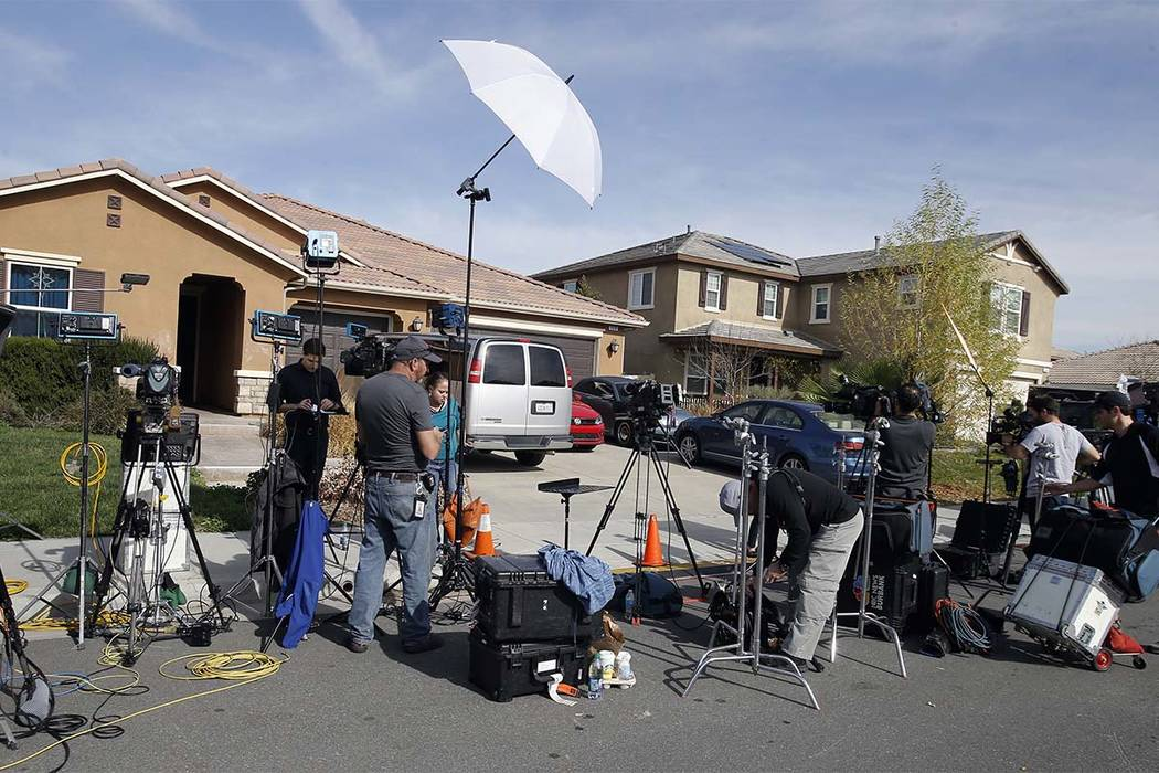 Members of the media work outside a home Tuesday, Jan. 16, 2018, where police arrested a couple on Sunday accused of holding 13 children captive, in Perris, California. (Alex Gallardo/AP)